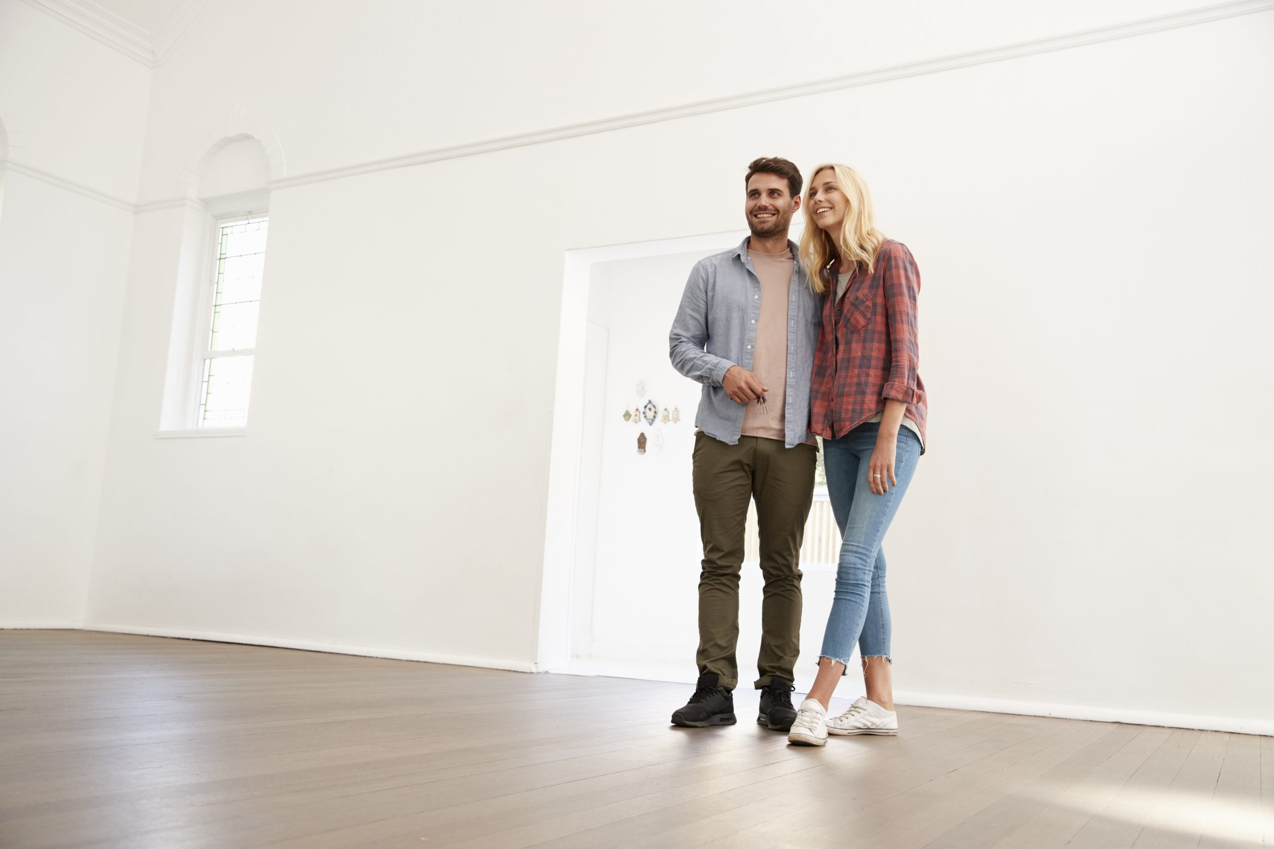 Happy couple moving into their rental home